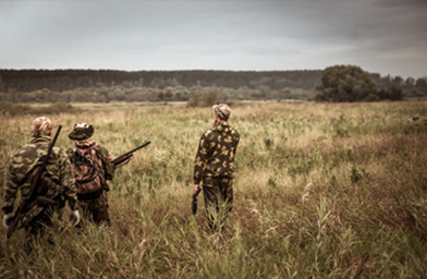 hunters in a field